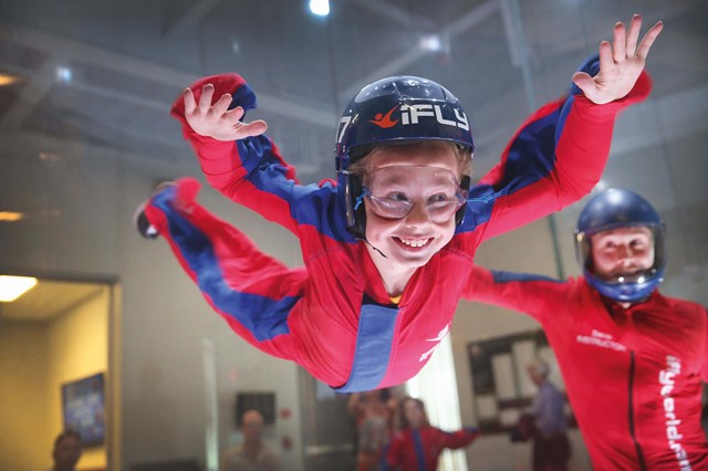 A young girl flying in the tunnel