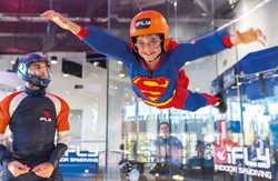 Superhero child flying at iFLY