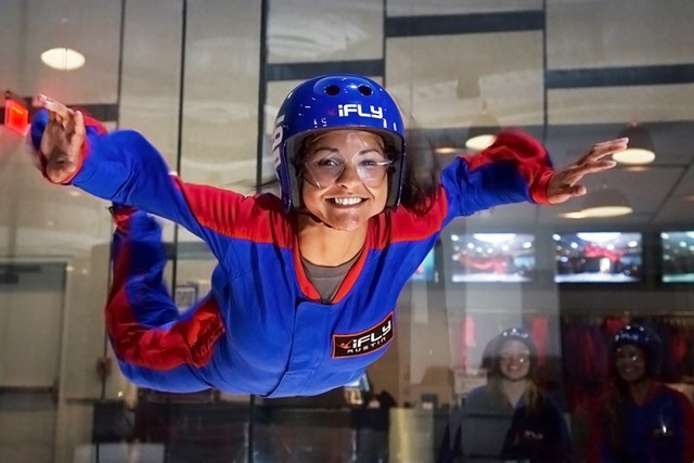 Smiling woman flying at iFLY