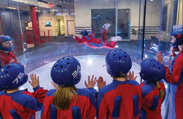 iFLY group watching indoor skydiving