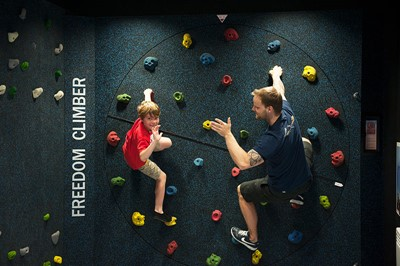 A boy and instructor at Freedom Climber