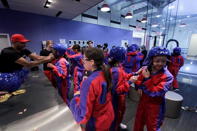 Children getting geared up for their flight